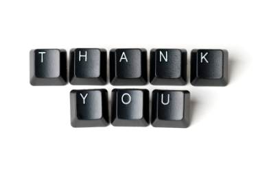 Thank you sign spelled with computer keys